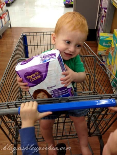 Chris holding the Parents Choice Diapers at Walmart #BabyDiapersSavings #CollectiveBias #shop