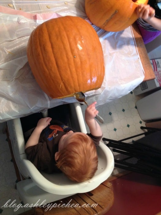 Pumpkin Carving with Kids - Chris using a spoon