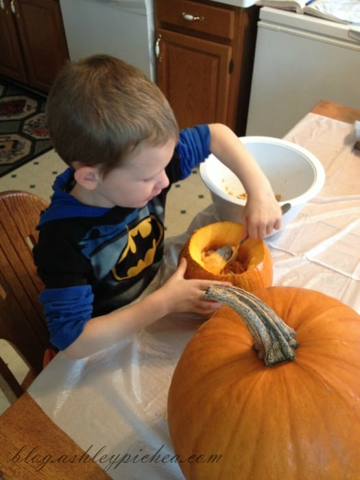 Pumpkin Carving with Kids - David cleaning his pumpkin