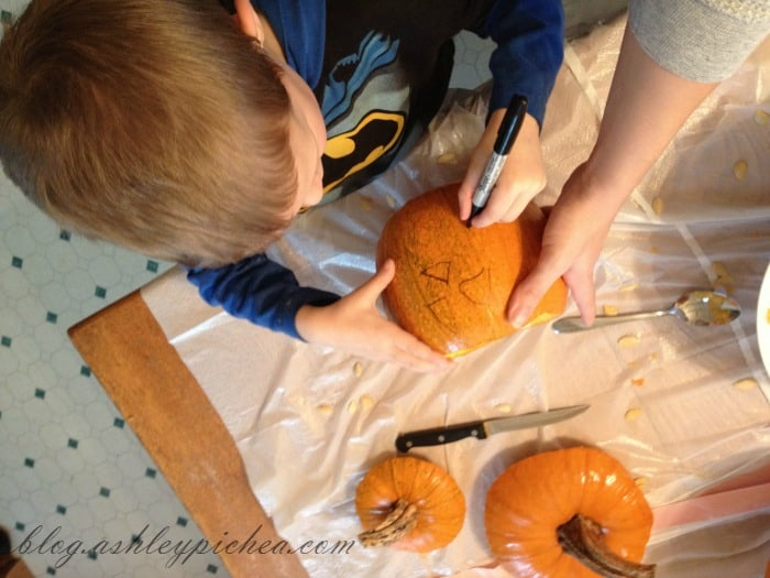 Pumpkin Carving with Kids - David drawing his pumpkin design