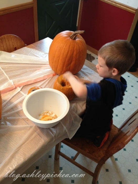 Pumpkin Carving with Kids - David gutting the pumpkin