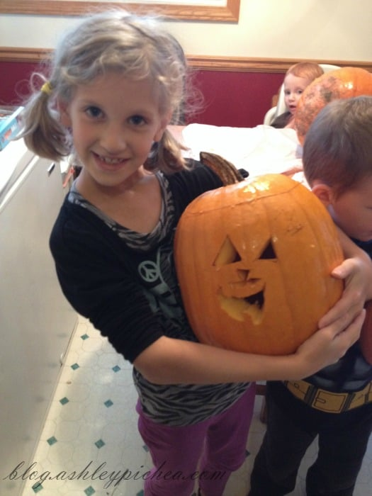 Pumpkin Carving with Kids - Jenny and her pumpkin