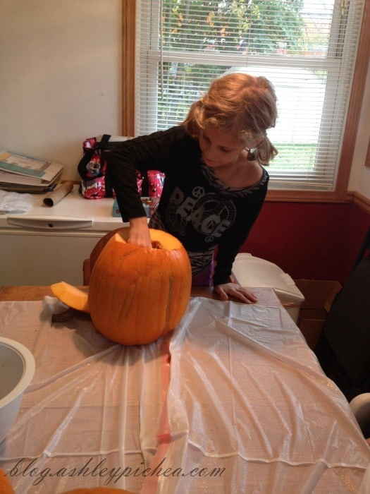 Pumpkin Carving with Kids - Jenny cleaning her pumpkin