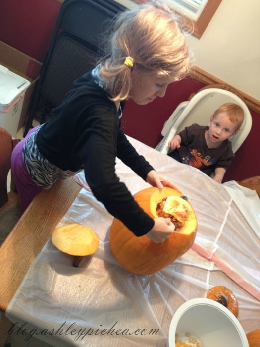 Pumpkin Carving with Kids - Jenny gutting the pumpkin