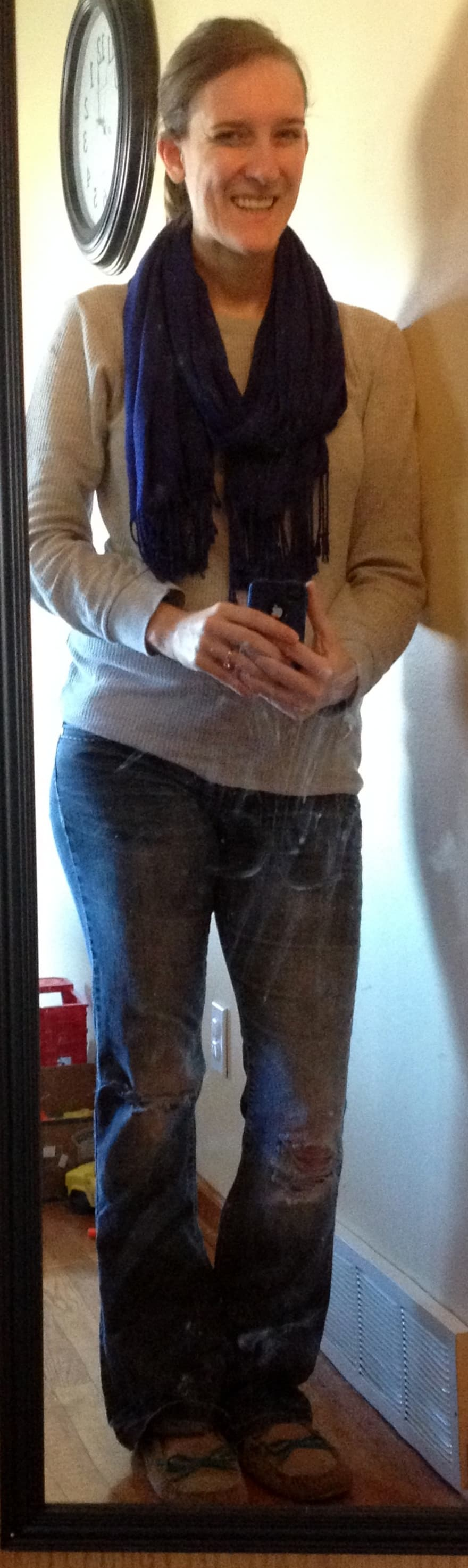 gray long-john shirt, blue scarf, holey jeans, slippers