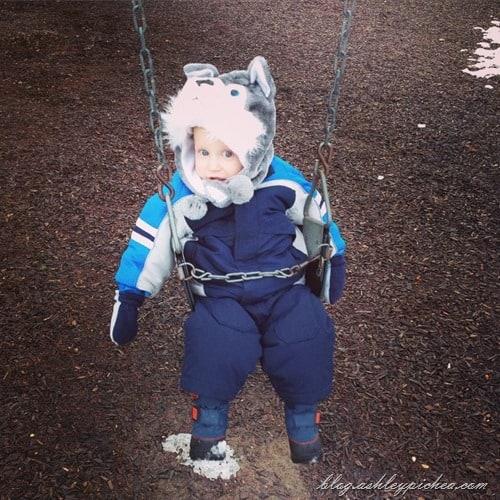 chris swinging at the park