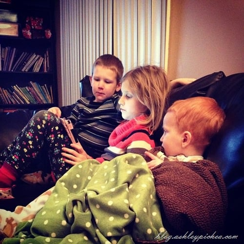 siblings watching kindle together