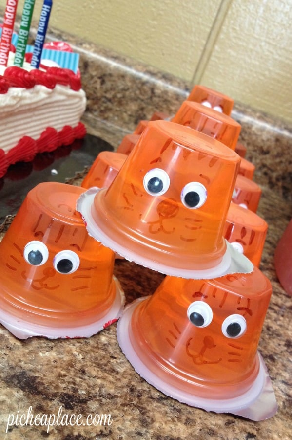 Tiger Jello Cup   Daniel Tiger party food idea   This Daniel Tiger birthday party was so much fun for the kids and super easy for this busy mom to throw together. Click through to the post to get ideas for Daniel Tiger themed food, crafts, activities, and more!