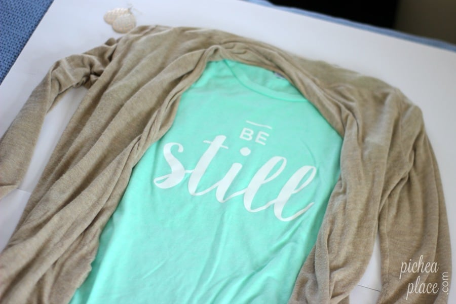 "The ""Be Still"" t-shirt pairs perfectly with jeans or a skirt, and it looks great with my beige cardigan and chevron teardrop earrings! 