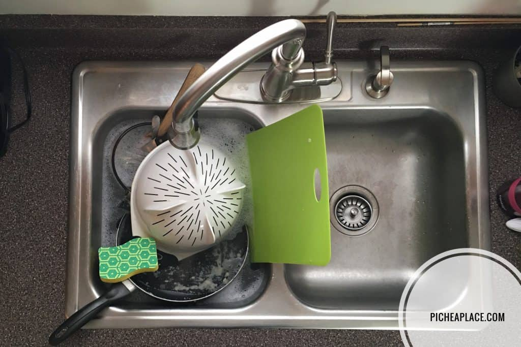 washing dishes with a Heavy Duty Scrub Dots sponge