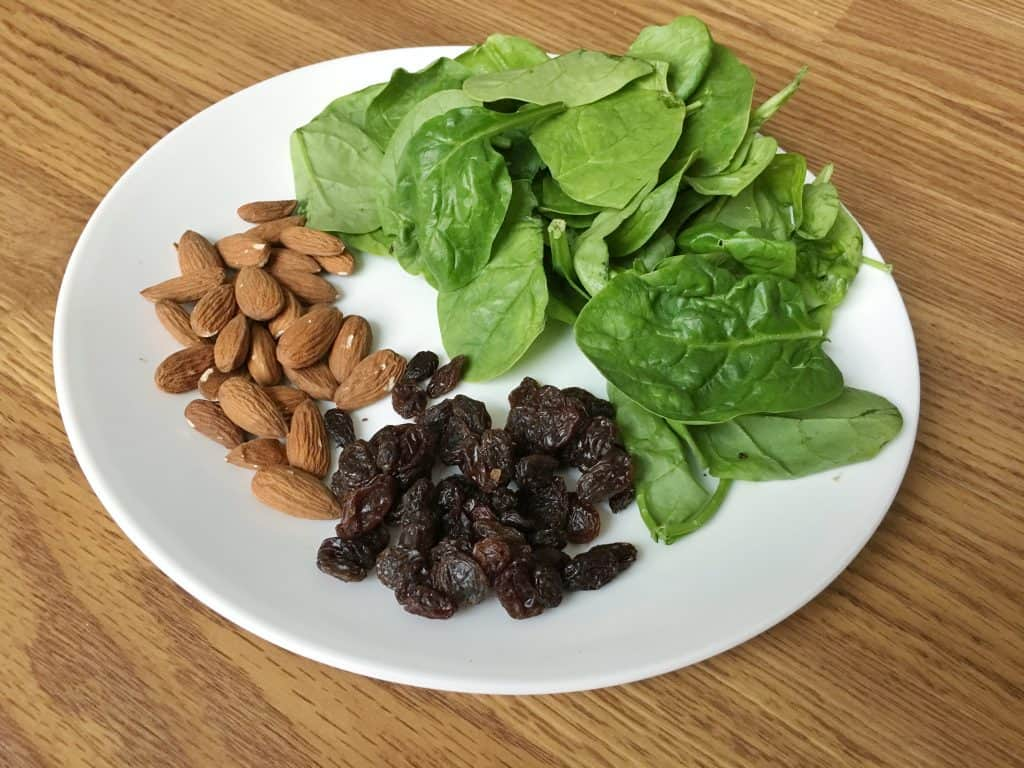 Better nutrition during pregnancy starts with eating healthy. Spinach Almond Raisin Salad is a quick and easy meal idea that you can throw together anytime of the day!